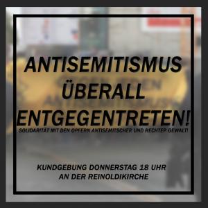 """Sharepic mit der Aufschrift """"Antisemitismus überall entgegentreten. Kundgebung Donnerstag 18:00 an der Reinoldikirche"""", im Hintergrund ein verschwommenes Transparent"""